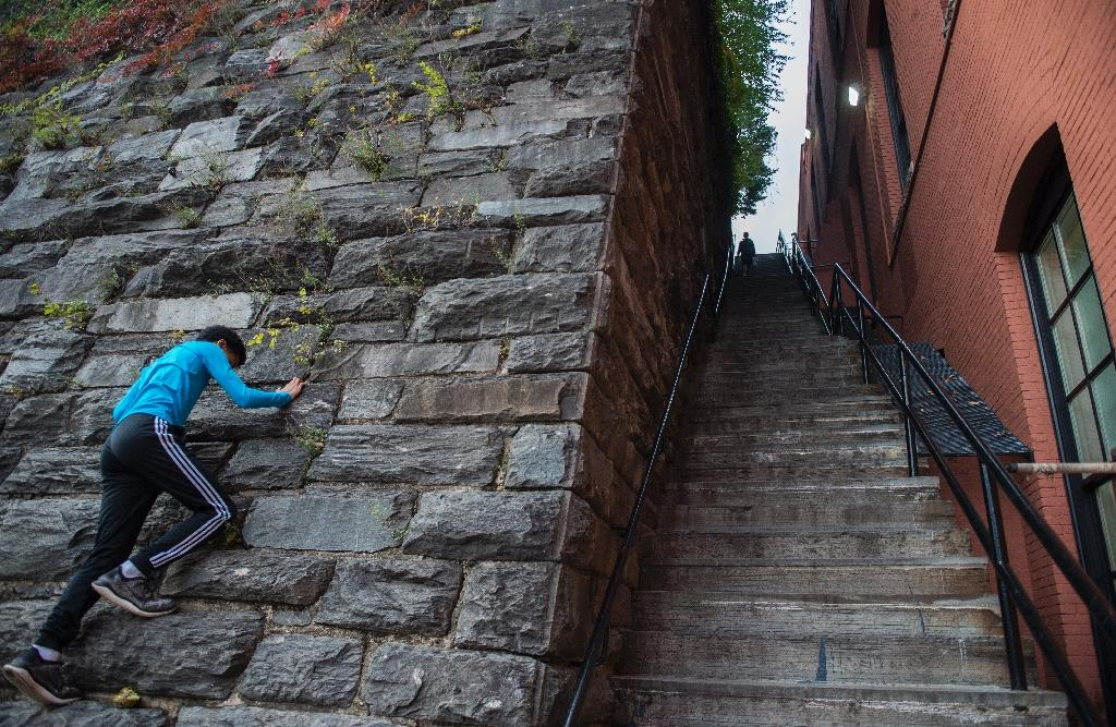 """These stairs in the Georgetown neighborhood of the US capital Washington were made famous by the 1973 movie """"The Exorcist"""" -- and could soon achieve historic landmark status (AFP Photo/ANDREW CABALLERO-REYNOLDS)"""