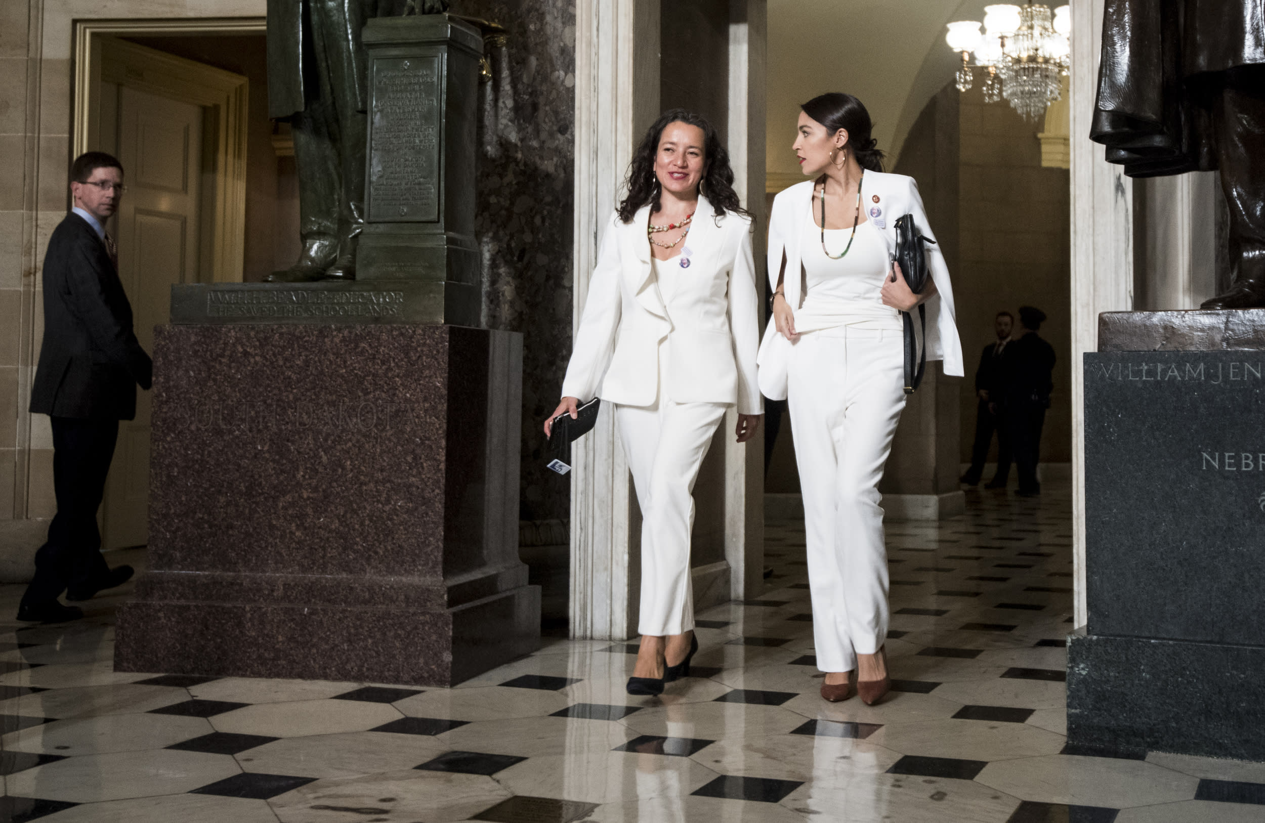 UNITED STATES - FEBRUARY 5: Rep. Alexandria Ocasio-Cortez, D-N.Y., right, walks with her State of the Union guest Ana Maria Archila to the House chamber for President Donald Trump's State of the Union address to a joint session of Congress in the Capitol on Tuesday, Feb. 5, 2019. (Photo By Bill Clark/CQ Roll Call)