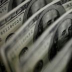 Dollar drops as traders prepare for Yellen to talk up stimulus