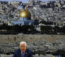 Palestinian president fires advisers as financial crisis hits