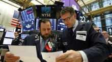 Stocks lack direction as investors wait for trade updates