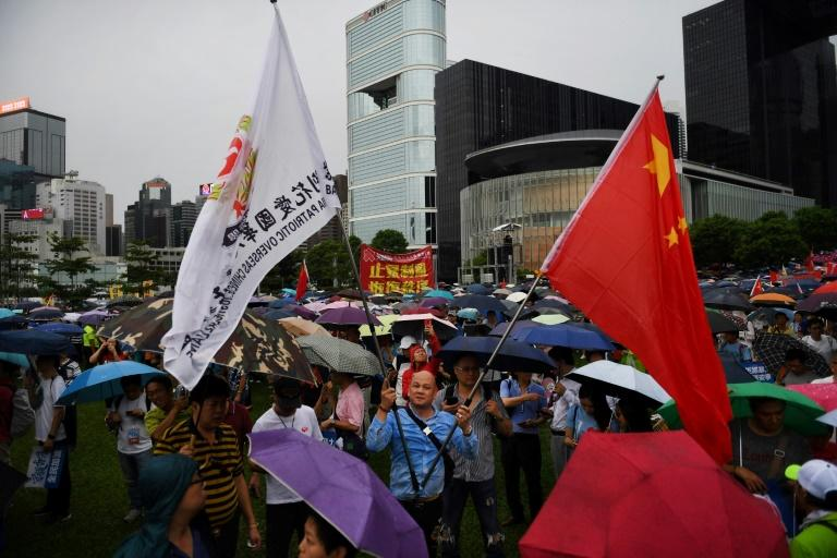 Pro-Beijing supporters also held a rival rally to condemn the pro-democracy protests (AFP Photo/Lillian SUWANRUMPHA)