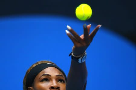 Serena Williams of the U.S. serves during her women's singles match against Silvia Soler-Espinosa of Spain at the China Open tennis tournament in Beijing September 29, 2014. REUTERS/Petar Kujundzic