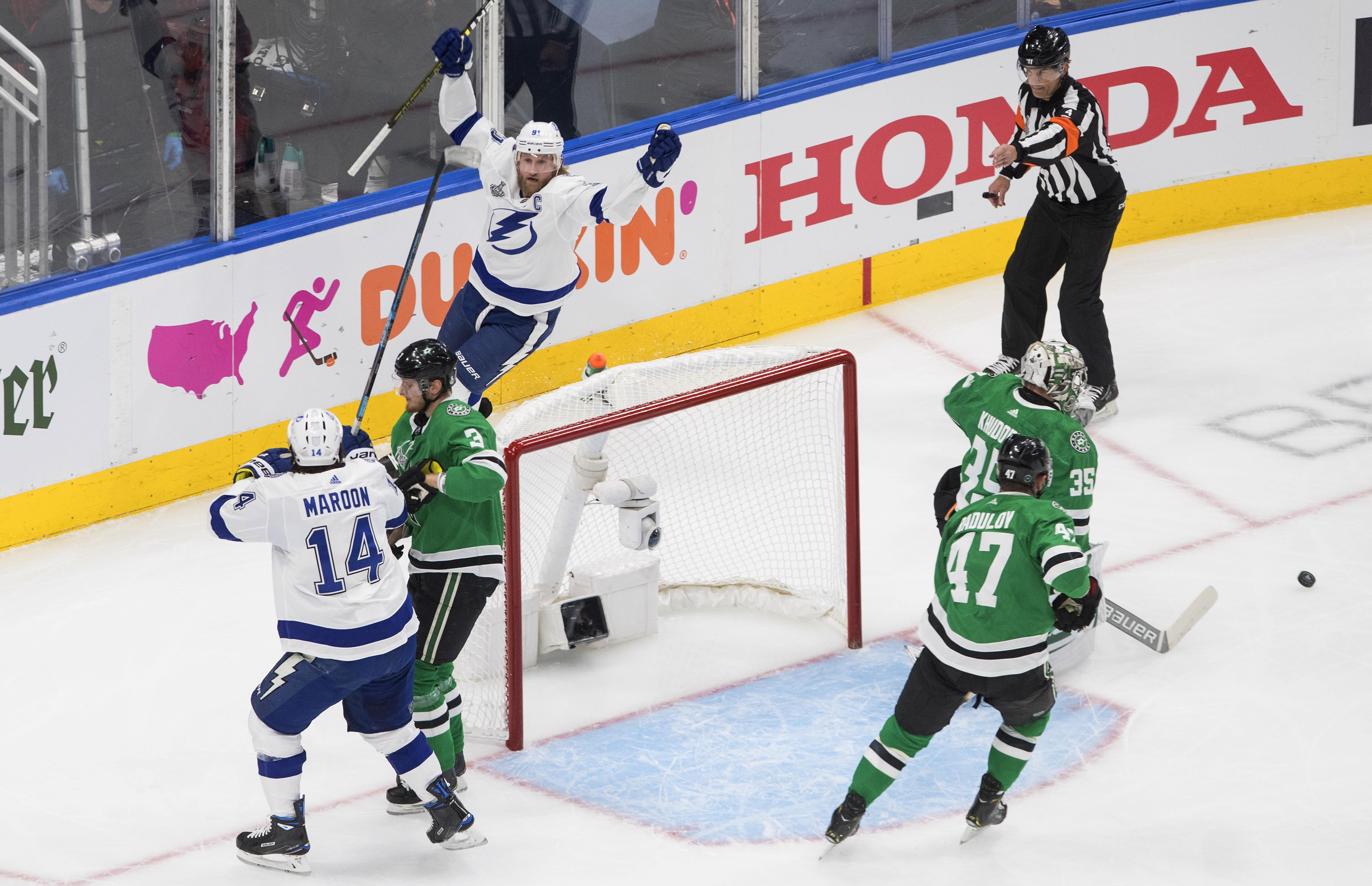 Tampa Bay Lightning center Steven Stamkos, top left, celebrates his goal against Dallas Stars goaltender Anton Khudobin (35) during the first period of Game 3 of the NHL hockey Stanley Cup Final, Wednesday, Sept. 23, 2020, in Edmonton, Alberta. (Jason Franson/The Canadian Press via AP)