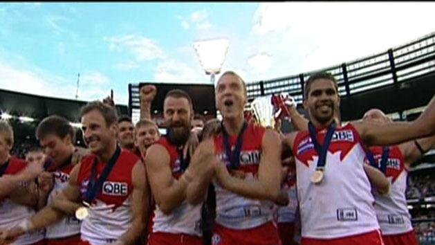 Swans welcome back premiership heroes