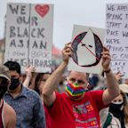 Police declared an unlawful assembly in Huntington Beach after groups clashed at a 'White Lives Matter' rally