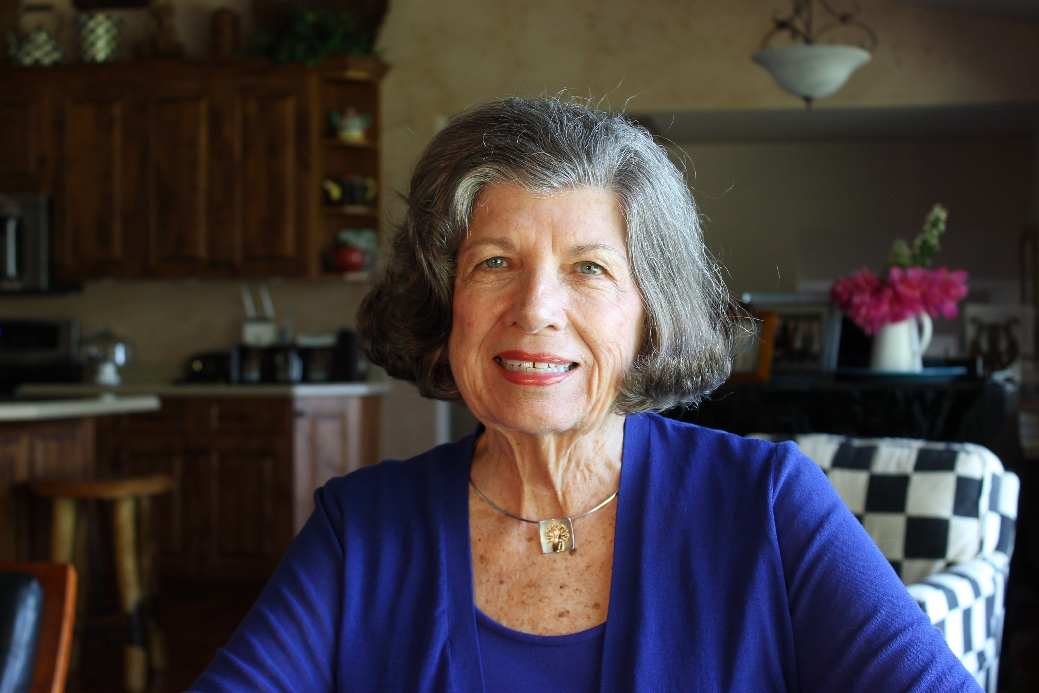This July 5, 2019 photo shows JoAnn Morgan, NASA's first female launch controller, at her home in Bigfork, Mont. Morgan, who worked on the Apollo 11 mission in 1969, went on to become the Kennedy Space Center's first female senior executive. Retired since 2003, she splits her time between Florida and Montana, and encourages young women to study engineering. (AP Photo/Krysta Fauria)
