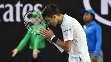 Fan yells advice, Djokovic thanks him