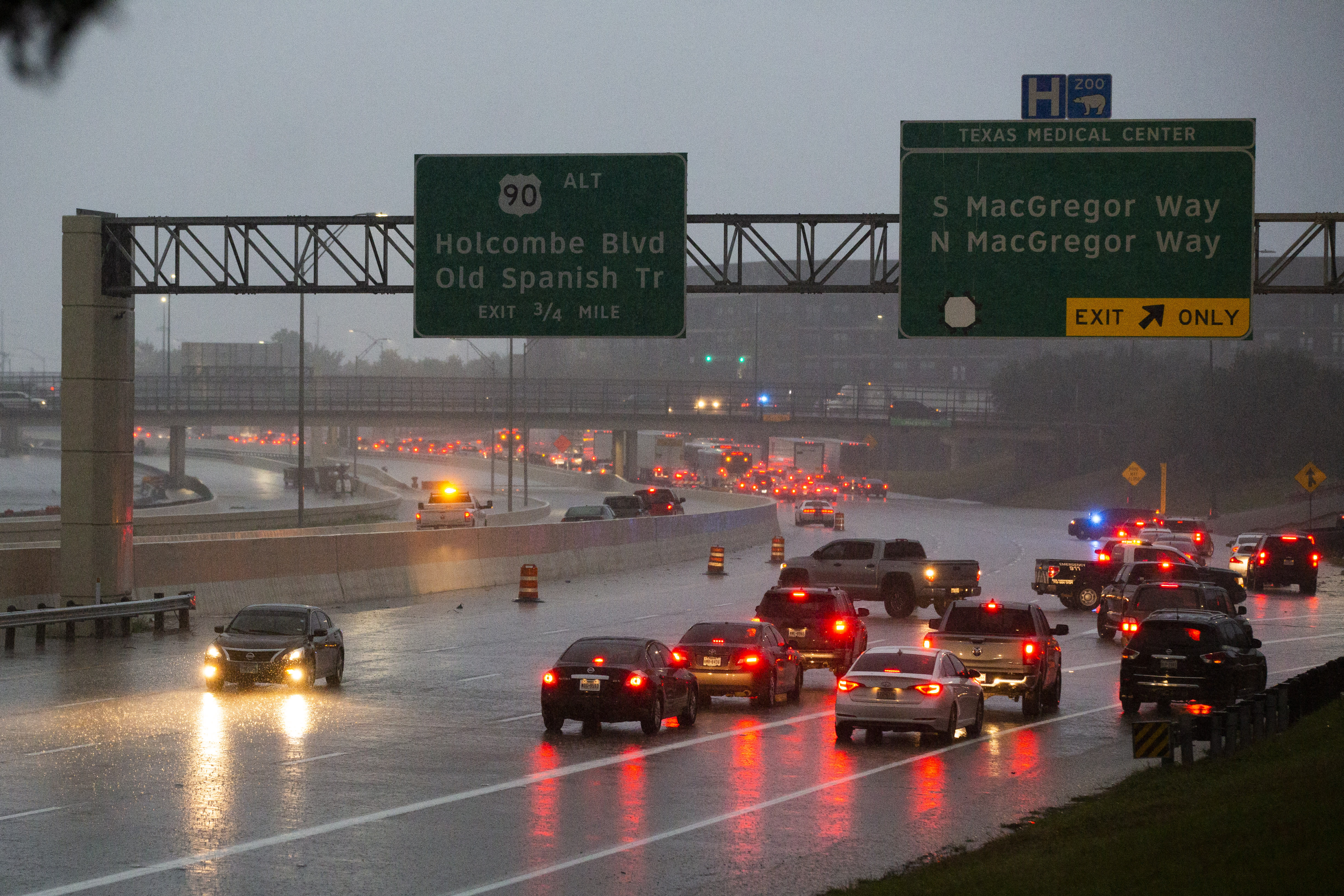 Cars turn around on southbound 288 because of a road blockage caused by Tropical Storm Beta flooding Tuesday, Sept. 22, 2020, in Houston. (Marie D. De Jesús/Houston Chronicle via AP)