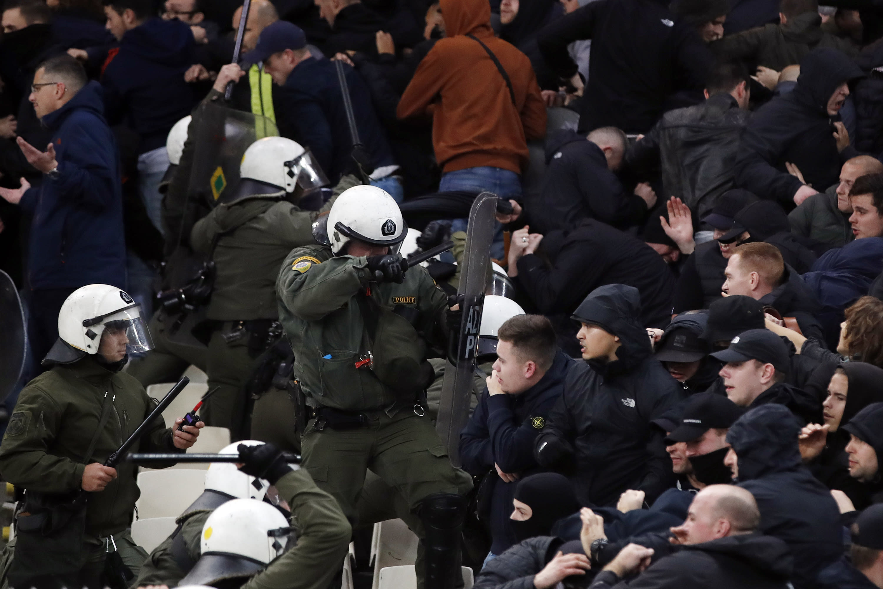 Greek riot police clash with Ajax fans before the start of a Group E Champions League soccer match between AEK Athens and Ajax at the Olympic Stadium in Athens, Tuesday, Nov. 27, 2018. (AP Photo/Thanassis Stavrakis)