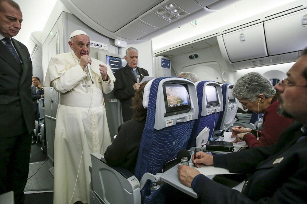 Pope Francis gestures during a meeting with the media onboard the papal plane while en route to Rome, Italy February 17, 2016. (Alessandro Di Meo/Pool/Reuters)