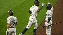 Mariners rally to topple Athletics 6-5 in DH opener