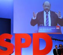 German SPD backs coalition talks, leader vows tough approach