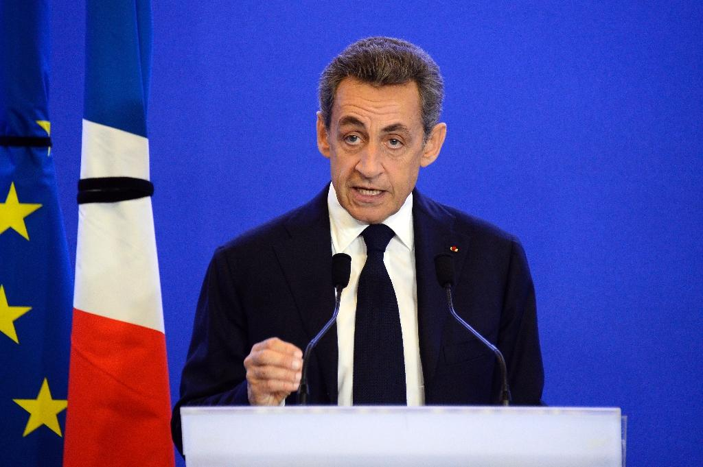 Former French President Nicolas Sarkozy speaks to reporters at the 'Les Republicains' party headquarters in Paris, on November 14, 2015