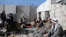 Battle rages over strategic Syrian town of Saraqeb as humanitarian catastrophe unfolds