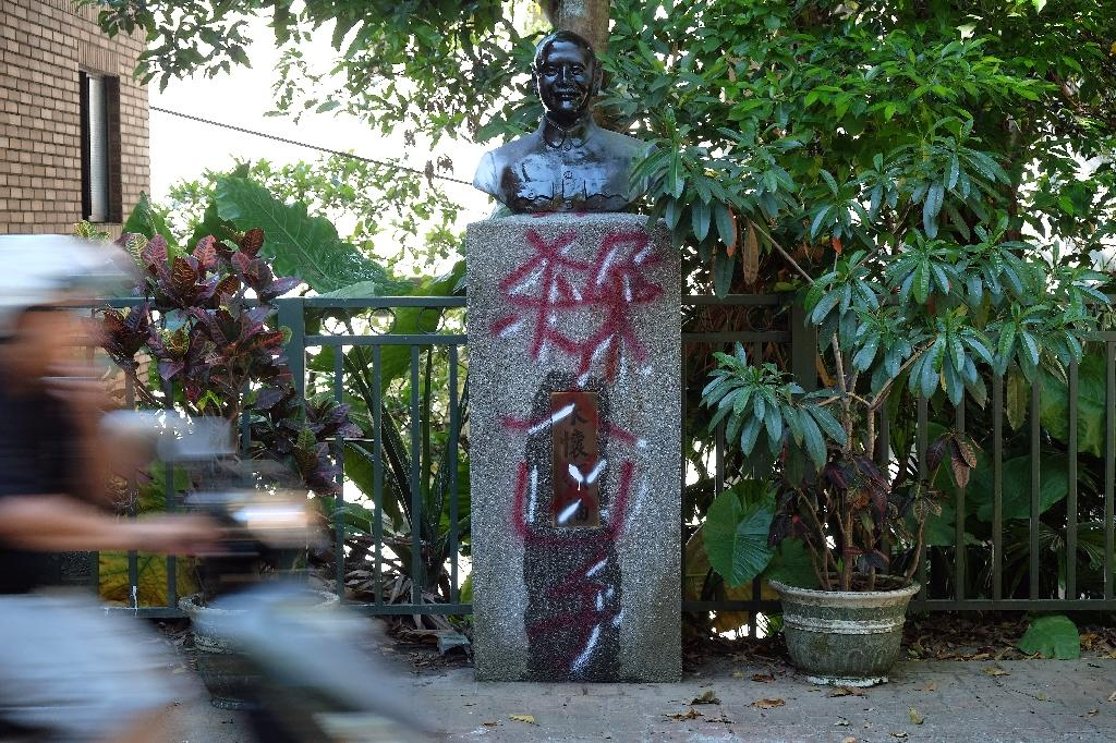 "A statue of Taiwan's Chiang Kai-shek defaced with the word ""murderer"""