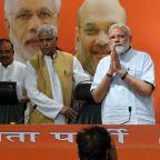 Stocks Hit Record and Rupee Climbs as Exit Polls Herald Modi Win