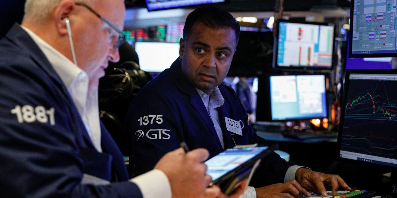 Stock Futures Slip Ahead of Fed Comments