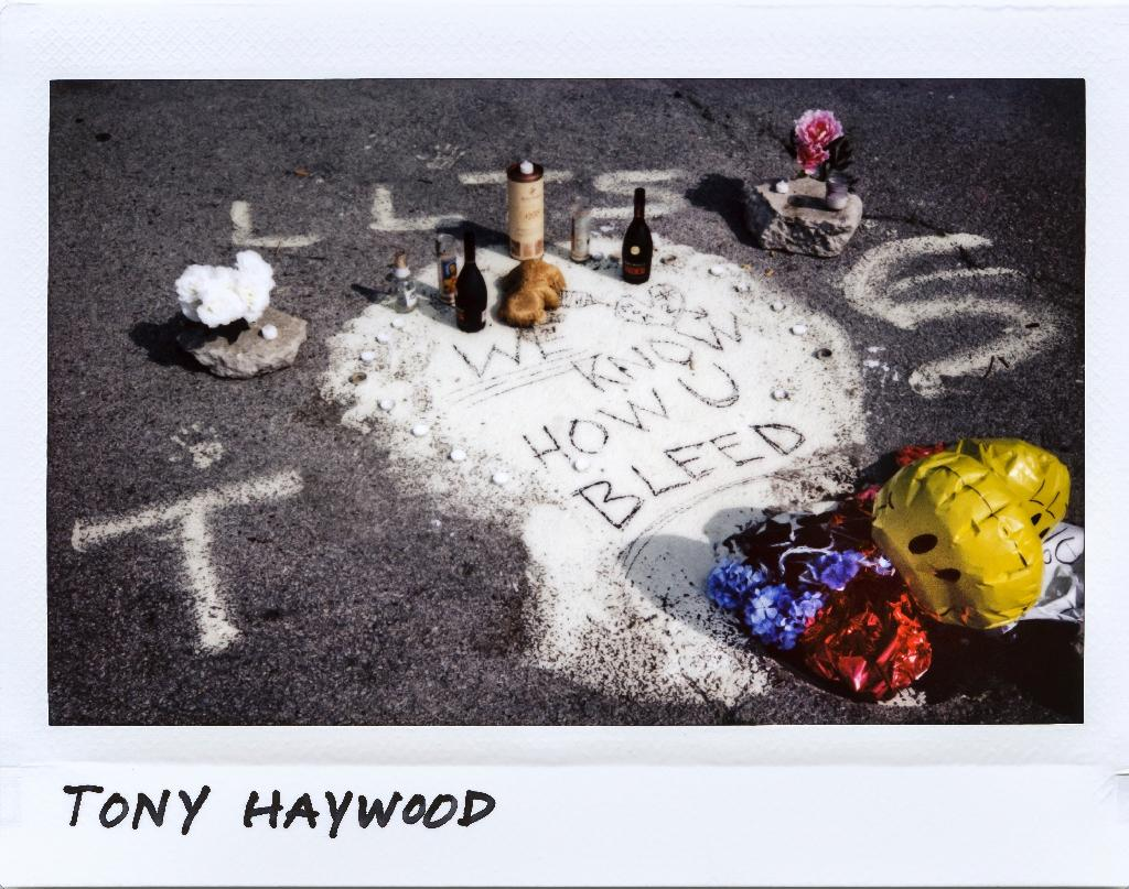 A memorial in a parking lot for Tony Haywood, 25, who was shot to death in south Chicago on July 23, 2017, pictured in a scan of a Polaroid image (AFP Photo/JIM YOUNG)