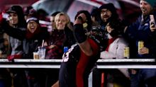 CFL offensive lineman Jon Gott celebrates touchdown with an ice-cold beer