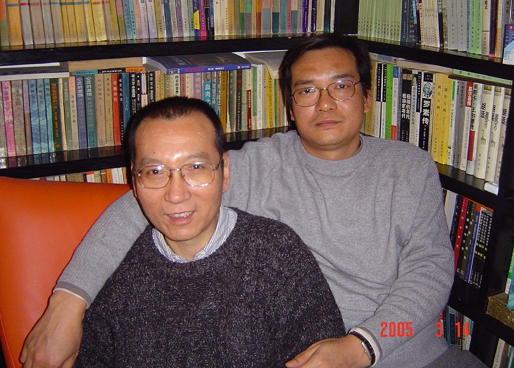 A file picture released by the family of Liu Xiaobo taken on March 14, 2005 shows 2010 Nobel peace laureate Liu Xiaobo, left, and his brother Liu Xiaoxuan (AFP Photo/Handout)