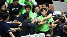 Taiwan lawmakers brawl over military pension cuts