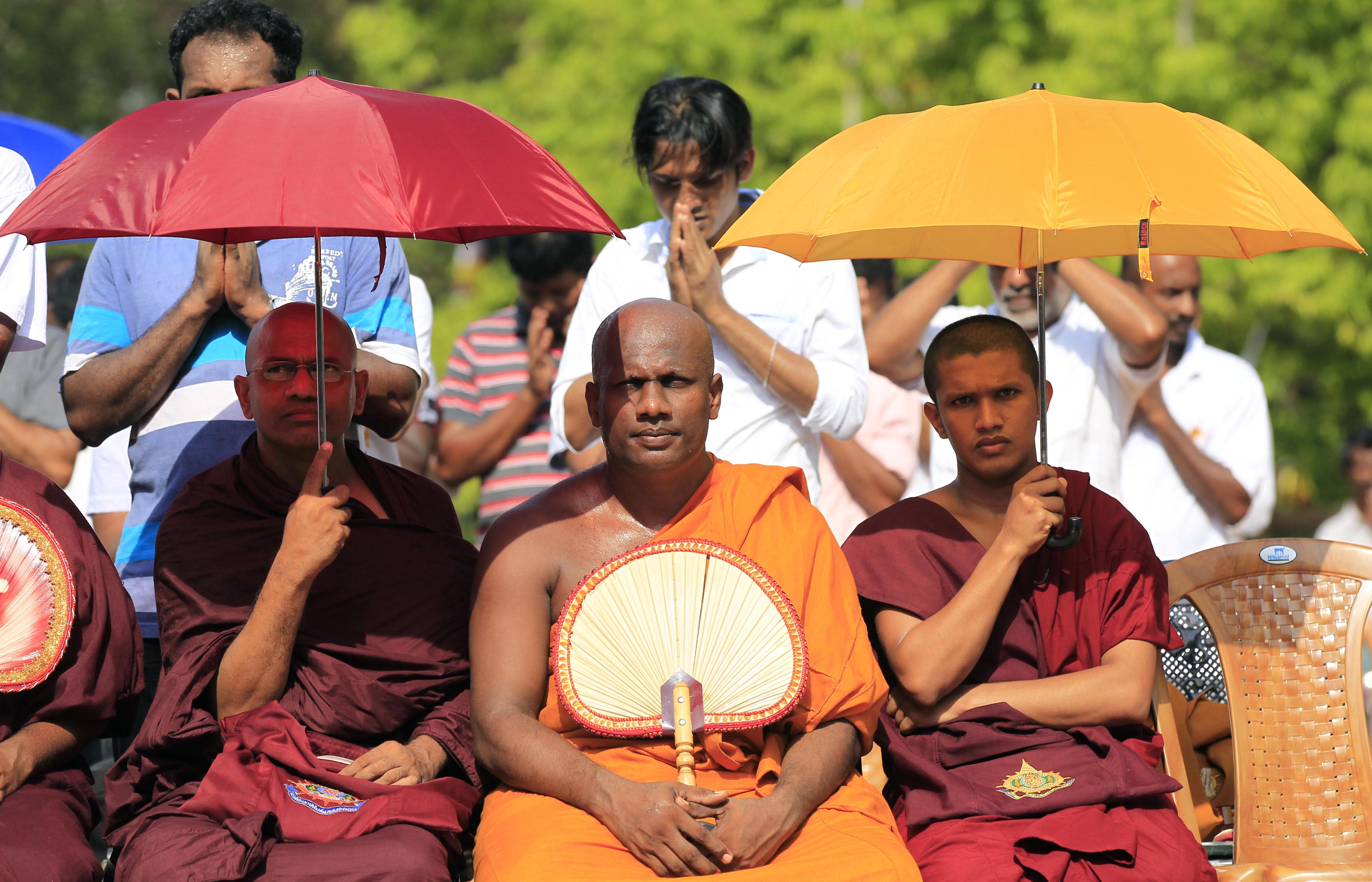 In this Sunday, March 31, 2013 photo, Sri Lankan Buddhist monks of Jathika Hela Urumaya, or National Heritage, a coalition political party of the Sri Lanka's ruling party take part in a convention in Colombo, Sri Lanka. The escalation in attacks and anti-Muslim rhetoric has caused fears of a new wave of ethnic violence in the country still recovering from a quarter-century civil war between the government, controlled by ethnic Sinhalese Buddhists, and a mainly Hindu ethnic Tamil rebel group. (AP Photo/Eranga Jayawardena)