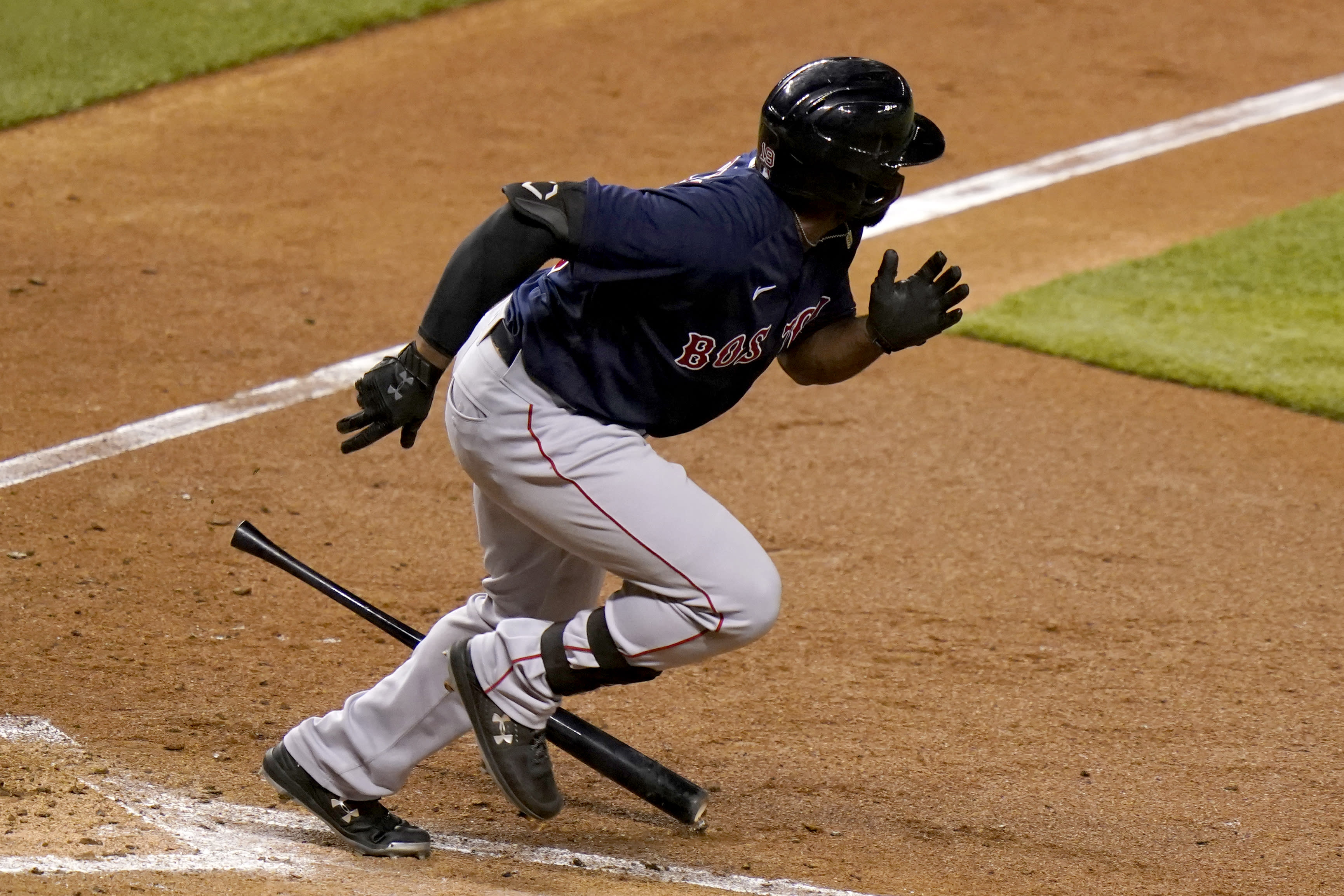 Boston Red Sox's Jackie Bradley Jr. runs after hitting a double to score Xander Bogaerts during the sixth inning of a baseball game against the Miami Marlins, Tuesday, Sept. 15, 2020, in Miami. (AP Photo/Lynne Sladky)