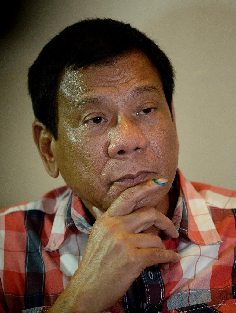 Philippine President-elect Rodrigo Duterte (pictured) was communist rebel leader Jose Maria Sison's student at a Manila university in the 1960s (AFP Photo/Noel Celis)