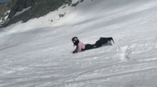 Snowboarder Grinds on Rail Successfully After Initial Failed Attempt