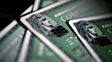 American Express Sees $2.4 Billion Earnings Hit From Tax Bill