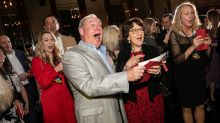 Boss surprises employees with $10 million bonus at holiday party