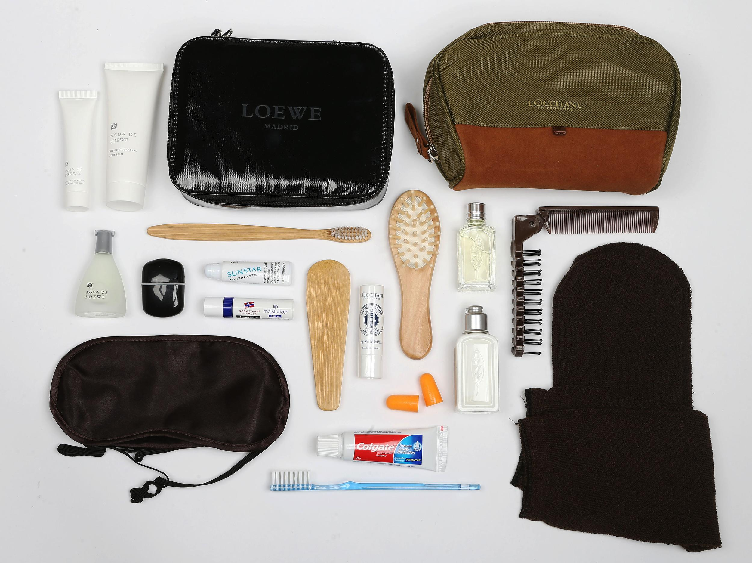 <p><strong>What do you get?</strong> First Class: Deluxe products that have a touch of the rain forest about them. Wooden accessories with an Eco element - hairbrush, shoe horn, toothbrush, dental flossing stick, toothpaste, body balm, moisturising face fluid, eau de toilette, lip balm, black silk eye mask, ear plugs<br /> Business Class: Verbena-infused L'Occitane cosmetics (eau de toilette, lip balm and body lotion), foldable brush/comb, toothbrush, toothpaste, pair of socks, eye mask, ear plugs</p>
