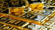Gold near one-month peak as yields, equities slide