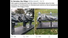 Sleeping homeless man on bench reported to Ohio cops. It was a sculpture of Jesus