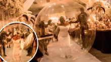Bride 'floats' down aisle in $700 giant bubble
