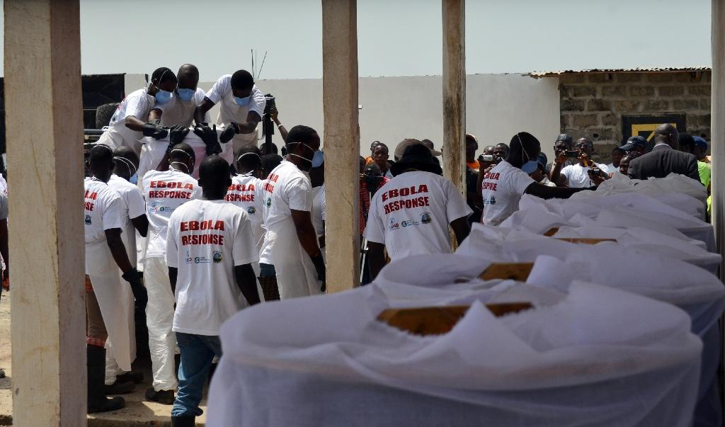 Workers at a crematorium load the remains of Ebola victims onto a vehicle to be taken to a safe burial site on March 7, 2015 in Monrovia (AFP Photo/Zoom Dosso)