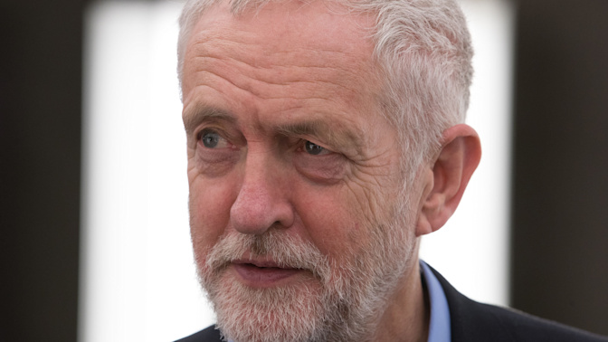 Corbyn demands damages from Tory MP over spy slur