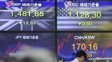 Asian shares inch higher as investors eye corporate earnings