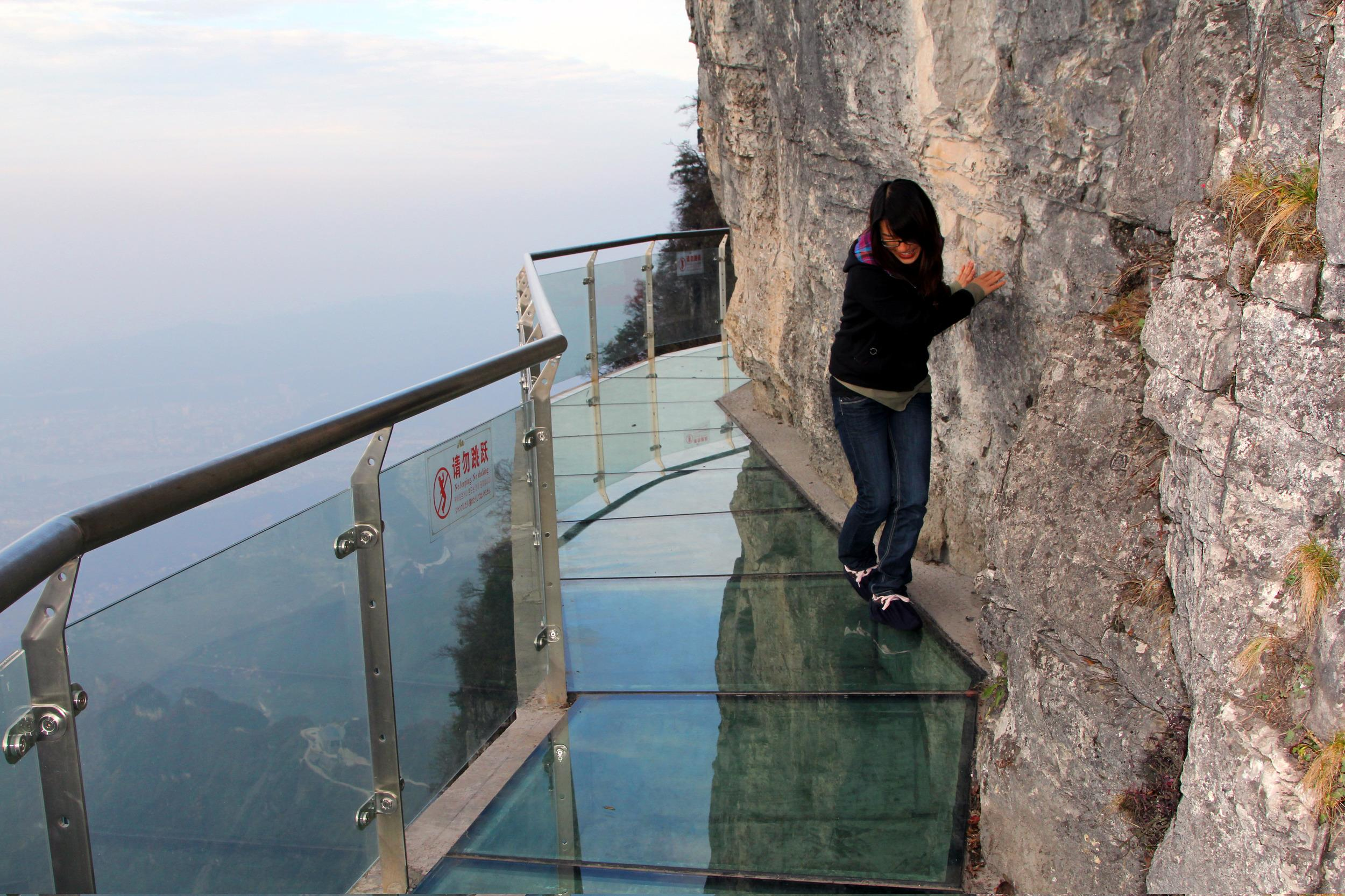 "Tourists with nerves of steel can step onto a 60-metre long glass walkway, aptly named the <a href=""http://travel.aol.co.uk/2011/11/10/walk-of-faith-glass-pavement-built-round-1-430-metre-high-mountain-in-china/"" target=""_blank"">Walk of Faith</a>, which sits 1,430 metres (4,690ft) up Tianmen Mountain in China. For those who need a confidence boost, Tianmen Mountain National Forest Park is often clouded in fog, making the drop hard to see. Extreme walkers will love the translucent floor on a clear day as it offers some unforgettable sightseeing."
