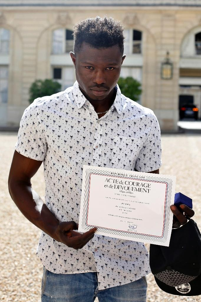 Mamoudou Gassama received a certificate of courage and dedication signed by Paris Police Prefect Michel Delpuech (AFP Photo/Thibault Camus)