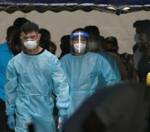 Singapore quarantines about 1,200 migrant workers, probes re-infections