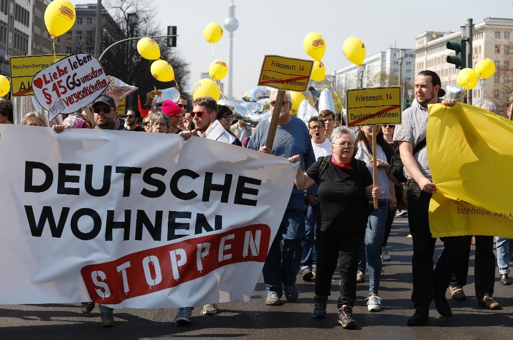 The protesters singled out companies such as Deutsche Wohnen and Vonovia, which have bought thousands of buildings and turned them into high-end apartments (AFP Photo/Odd ANDERSEN)