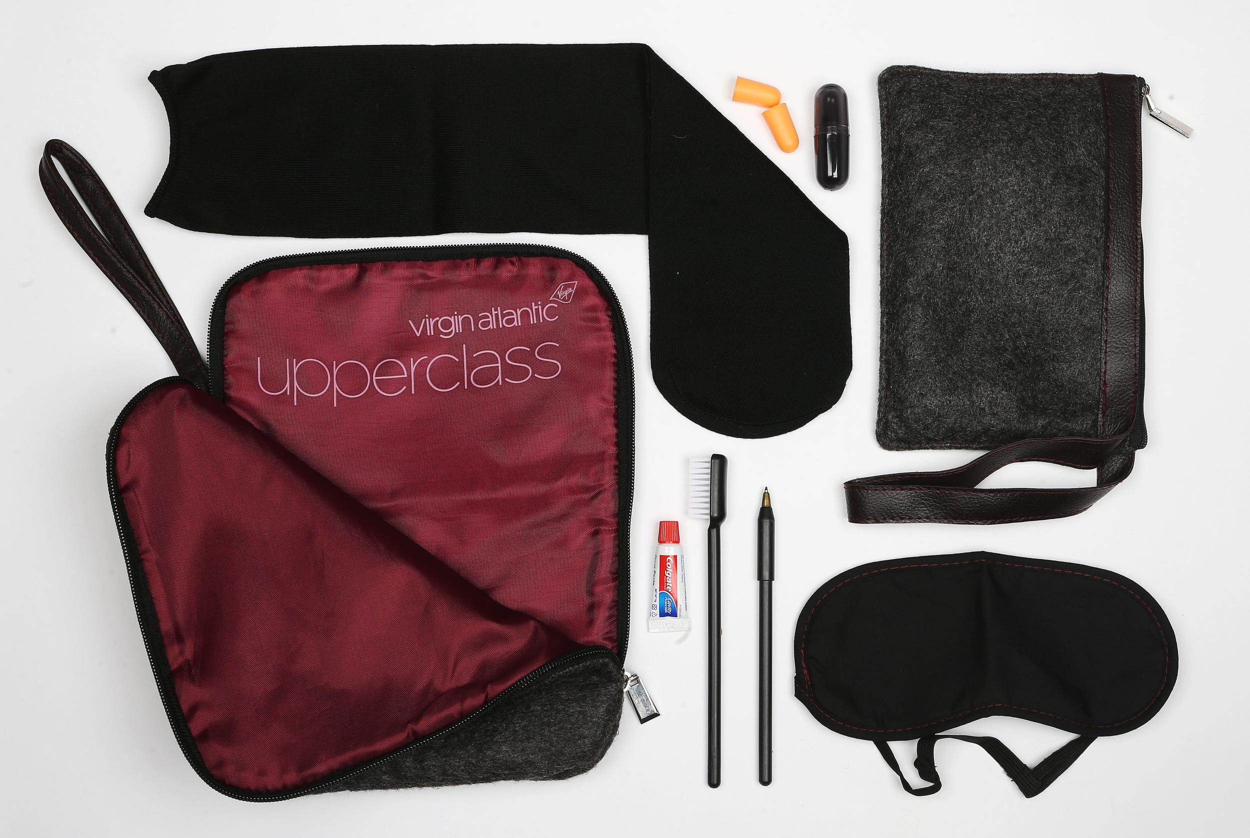 <p><strong>What do you get?</strong> The Outbound Kit is tablet sized, charcoal grey with black-cherry stitching and a snazzy, silk lining (branded attractively as Virgin Atlantic Upper Class) and contains socks, a pen, toothbrush, eye mask, tissues, toothpaste, ear plugs, a paper envelope for Change for Children<br /> The Inbound Kit is perfectly sized as a change purse (or pencil case for a lucky child) and contains: Socks, eye mask, toothbrush, toothpaste, tissues, pen, ear plugs, Change for Children envelope<br /> <strong>Best bit of the kit?</strong> The bags. Best-thought out bags.</p>