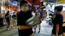 Apple Daily: Hong Kong newspaper defiant after crackdown