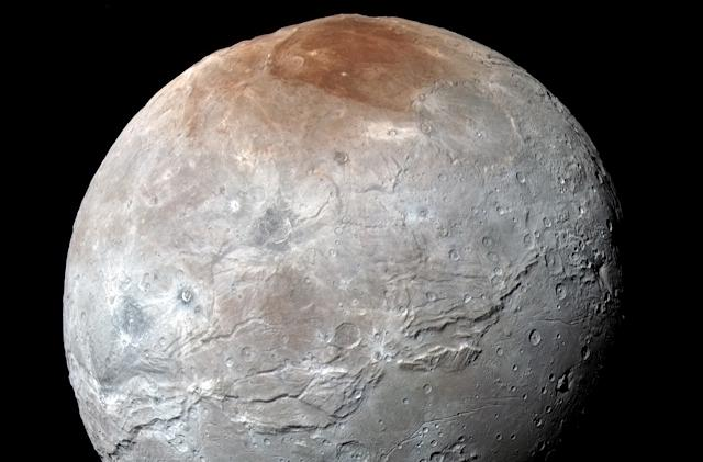 Pluto's moon Charon got its red toupée from the dwarf planet