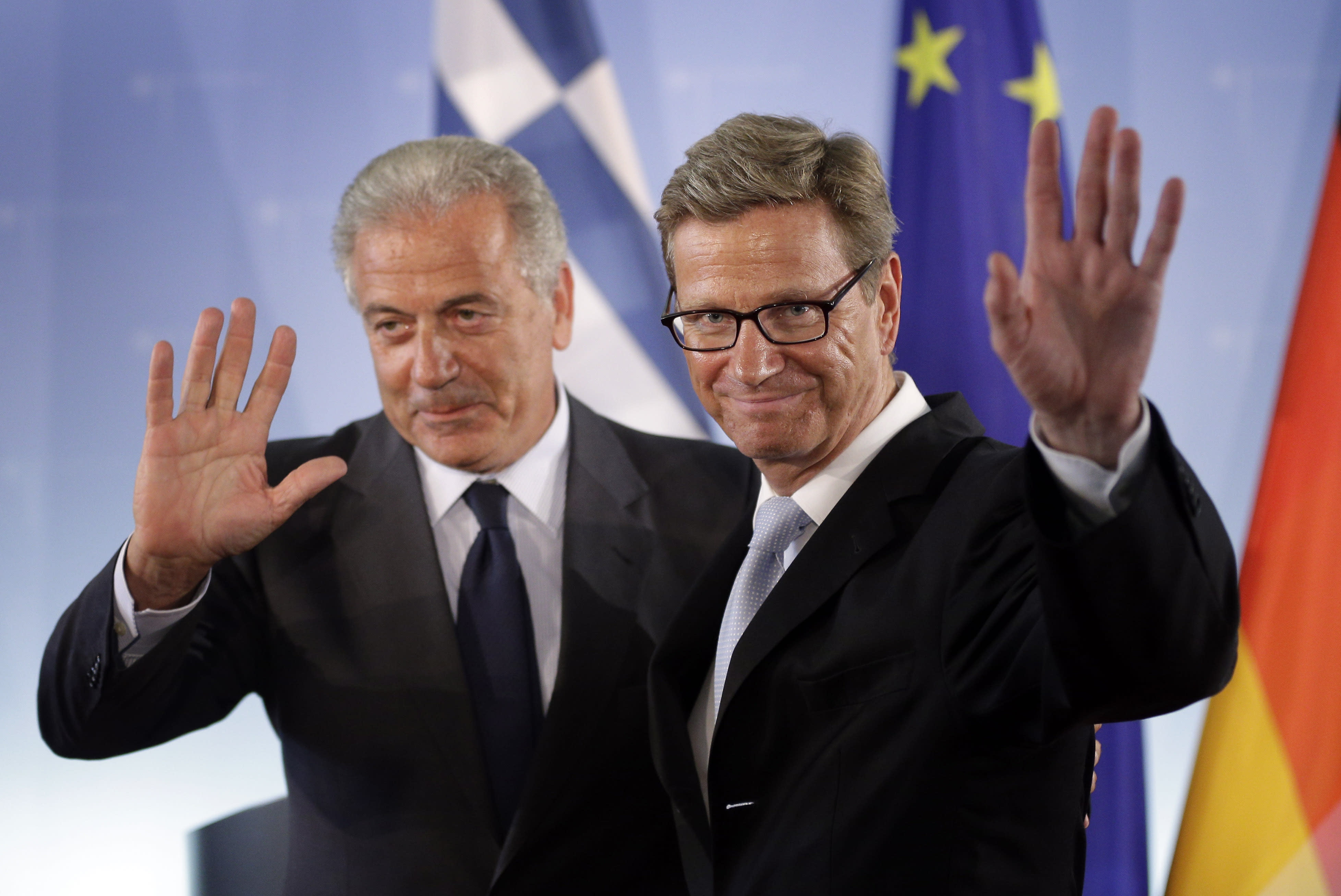 German Foreign Minister Guido Westerwelle right, and his counterpart from Greece, Dimitris Avramopulos, left, wave farewell after a joint press conference as part of a meeting at the foreign office in Berlin, Germany, Monday, Aug. 20, 2012. (AP Photo/Michael Sohn)