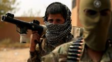 Kurd-led forces overrun last IS-held village in Syria: monitor