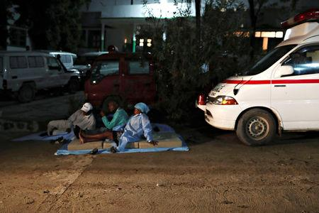 Hospital workers rest outside of a hospital in Port-de-Paix, Haiti October 7, 2018 after an earthquake hit northern Haiti late on Saturday. REUTERS/Ricardo Rojas
