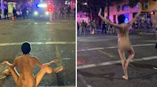 Nude protester calms riot as US city plunges into turmoil